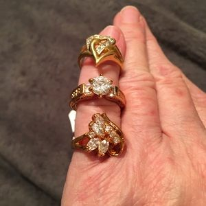 3 NWT gold electroplated and faux diamond rings.
